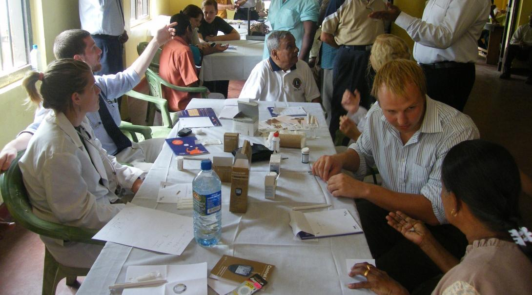 Projects Abroad interns and local doctors going over their notes at the hospital during their pharmacy internship in Sri Lanka.